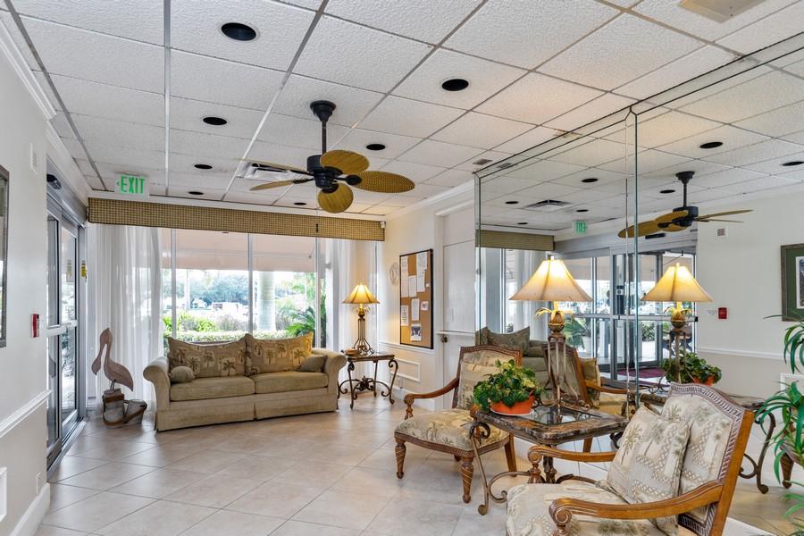 Real Estate Photography - 3 Bluebill Ave Unit 812, Naples, FL, 34108 - Lobby