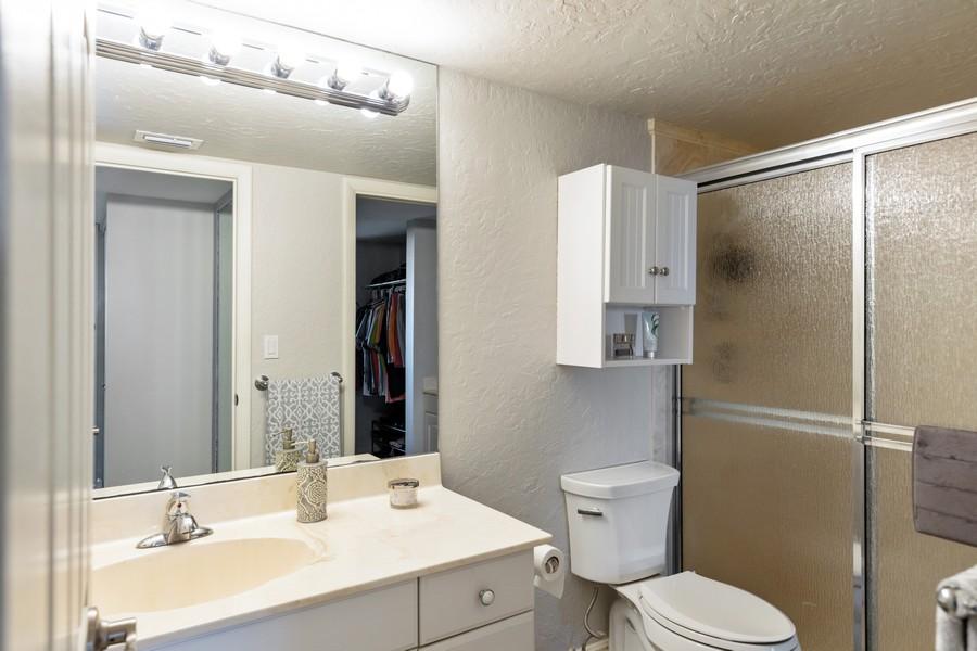 Real Estate Photography - 3 Bluebill Ave Unit 812, Naples, FL, 34108 - Master Bathroom