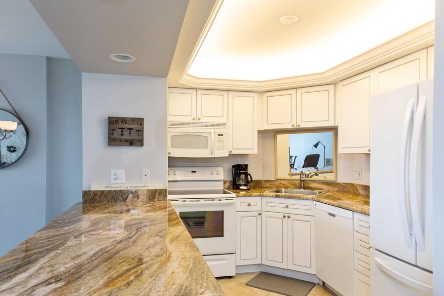 Real Estate Photography - 3 Bluebill Ave Unit 812, Naples, FL, 34108 - Kitchen