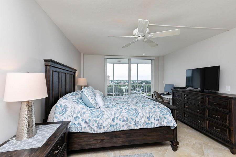 Real Estate Photography - 3 Bluebill Ave Unit 812, Naples, FL, 34108 - Master Bedroom