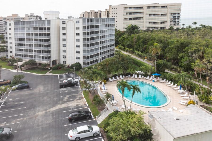Real Estate Photography - 3 Bluebill Ave Unit 812, Naples, FL, 34108 - Pool