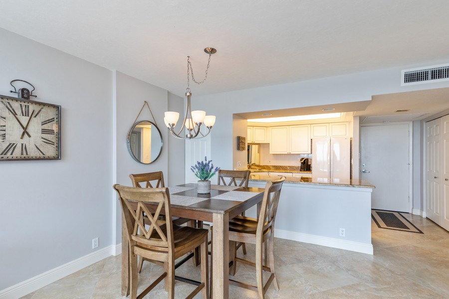 Real Estate Photography - 3 Bluebill Ave Unit 812, Naples, FL, 34108 - Dining Area