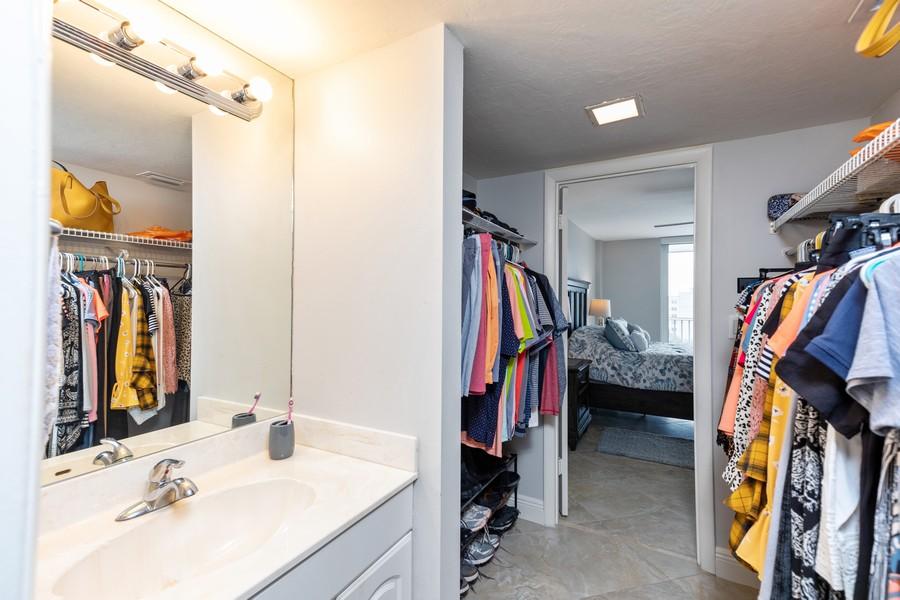 Real Estate Photography - 3 Bluebill Ave Unit 812, Naples, FL, 34108 - Closet