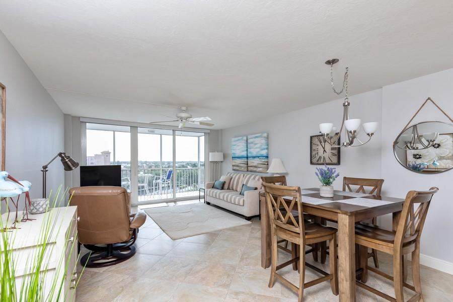 Real Estate Photography - 3 Bluebill Ave Unit 812, Naples, FL, 34108 - Living Room / Dining Room