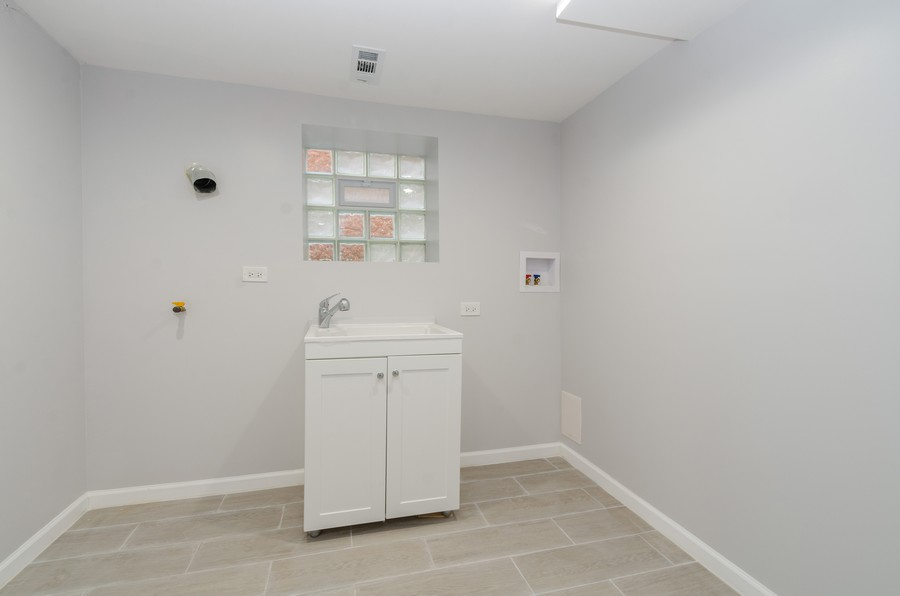 Real Estate Photography - 8223 S Chappel Ave, Chicago, IL, 60617 - Laundry Room