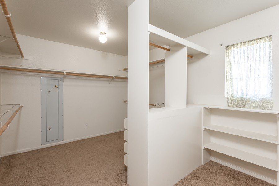 Real Estate Photography - 1651 Roma Ct, West Sacramento, CA, 95691 - Master Bedroom Closet
