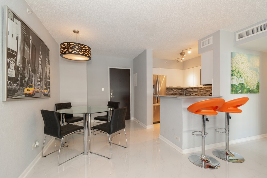 Real Estate Photography - 1500 Bay Road apt 654S, Miami Beach, FL, 33139 - Dining Room