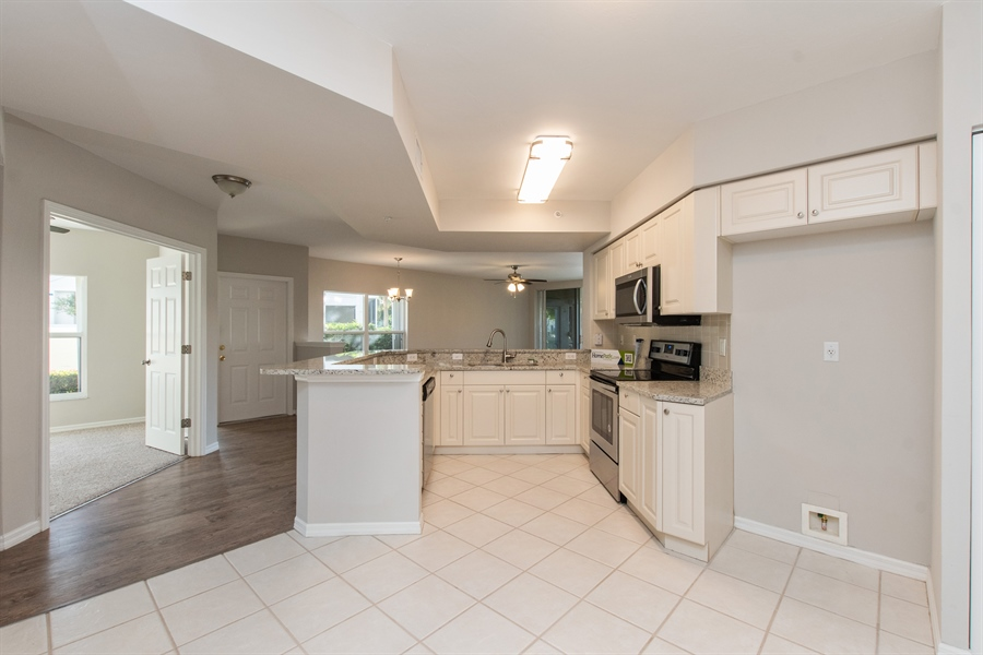 Real Estate Photography - 5070 CEDAR SPRINGS DR. UNIT 101, NAPLES, FL, 34110 -