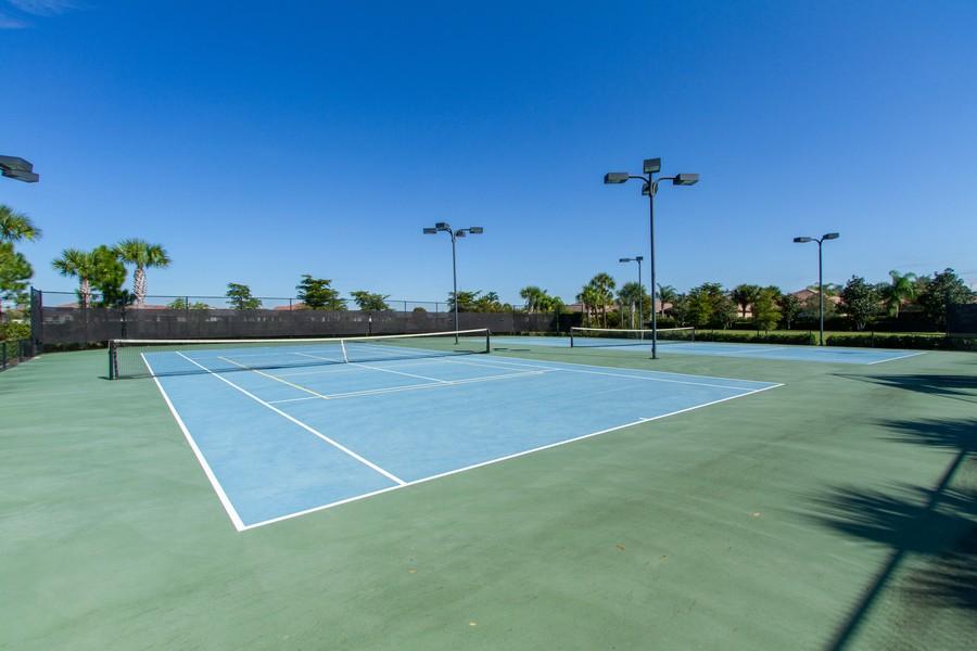Real Estate Photography - 2099 Sagebrush Cir, Naples, FL, 34120 - Tennis Court