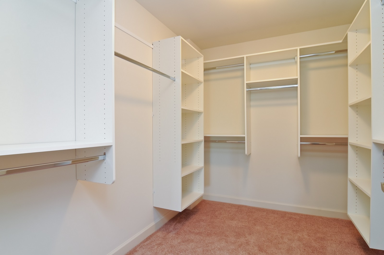 Real Estate Photography - 450 Village Green, Unit 216, Lincolnshire, IL, 60069 - Master Bedroom Closet