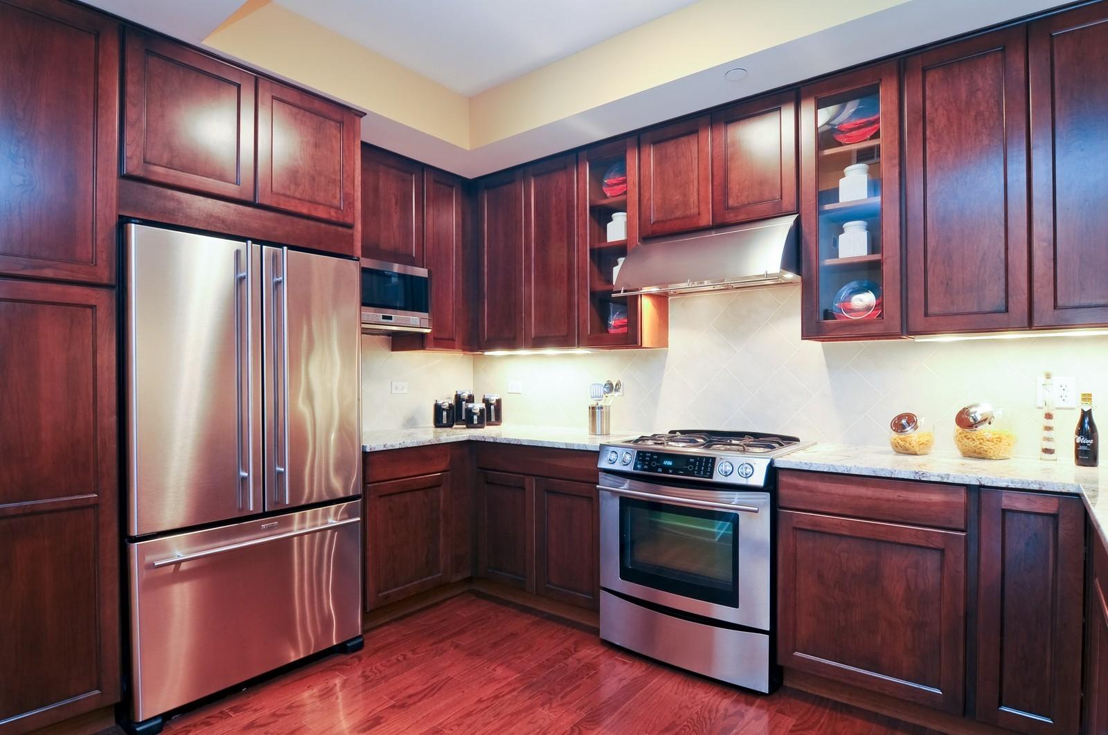 Real Estate Photography - 450 Village Green, Unit 213, Lincolnshire, IL, 60069 - Kitchen