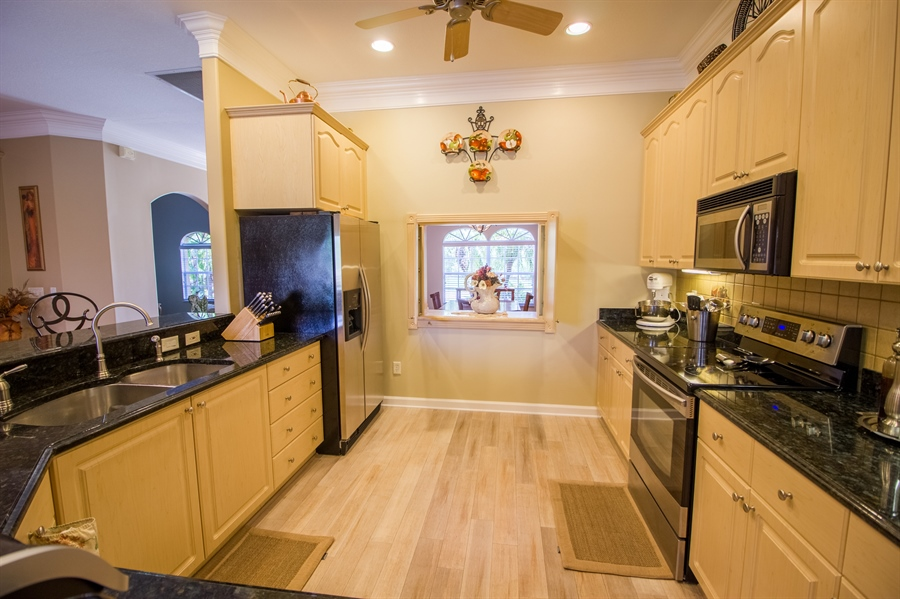 Real Estate Photography - 108 SW Lion Ln, Port Saint Lucie, FL, 34953 - Kitchen W/Pass-Through