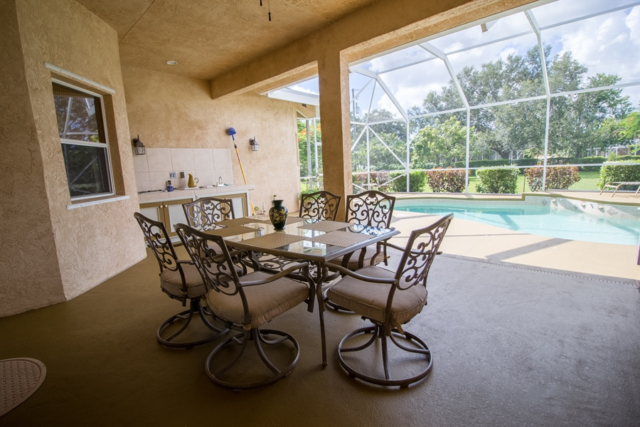 Real Estate Photography - 108 SW Lion Ln, Port Saint Lucie, FL, 34953 - Porch, Pool, and Outdoor Kitchen