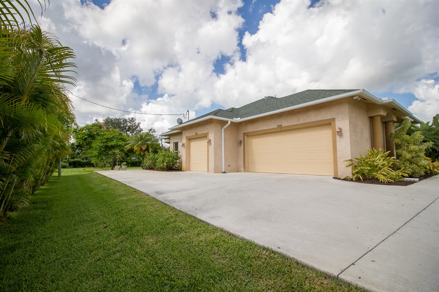 Real Estate Photography - 108 SW Lion Ln, Port Saint Lucie, FL, 34953 - 3 Car Garage