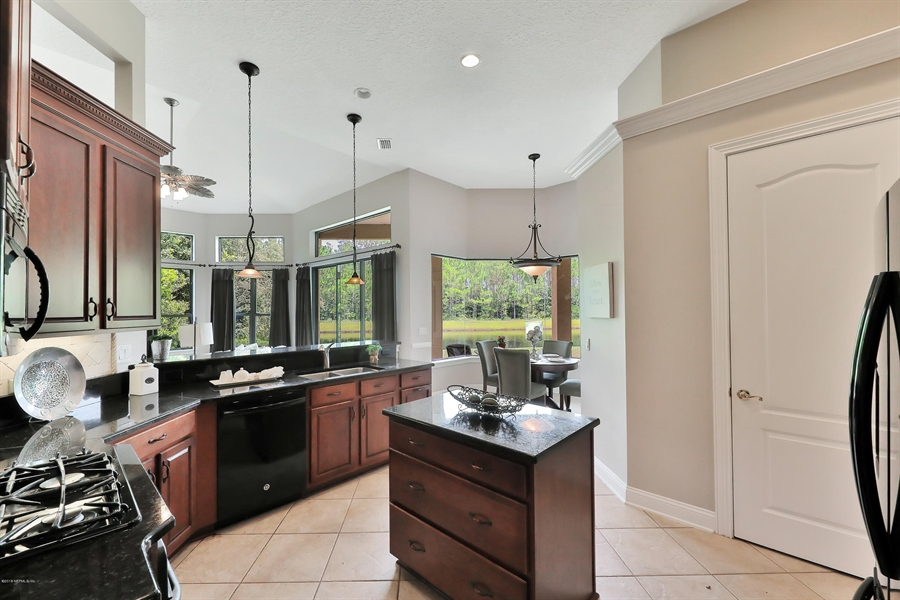 Real Estate Photography - 140 Saint Johns Forest Blvd, Saint Johns, FL, 32259 - KITCHEN WITH GRANITE COUNTERS