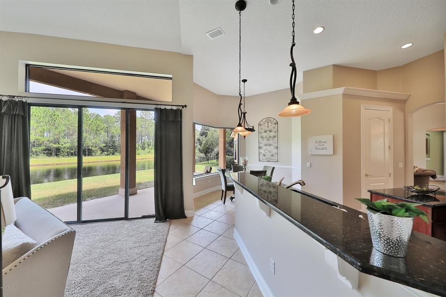 Real Estate Photography - 140 Saint Johns Forest Blvd, Saint Johns, FL, 32259 - BREAKFAST BAR OPEN TO FAMILY ROOM