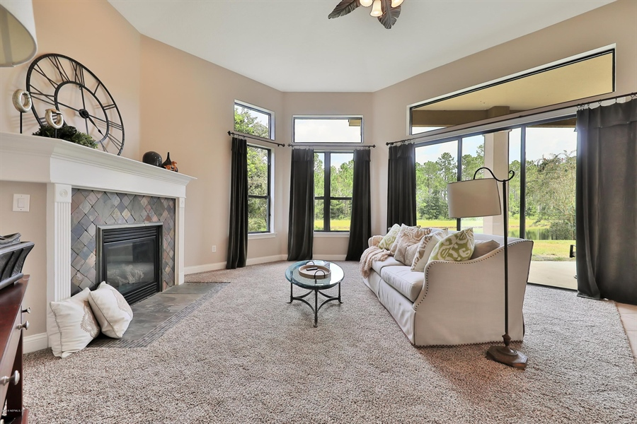Real Estate Photography - 140 Saint Johns Forest Blvd, Saint Johns, FL, 32259 - FAMILY ROOM WITH GAS FIREPLACE