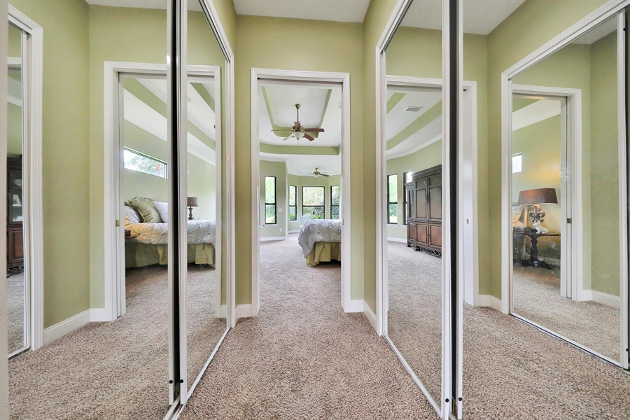 Real Estate Photography - 140 Saint Johns Forest Blvd, Saint Johns, FL, 32259 - MASTER WALK-IN CLOSETS