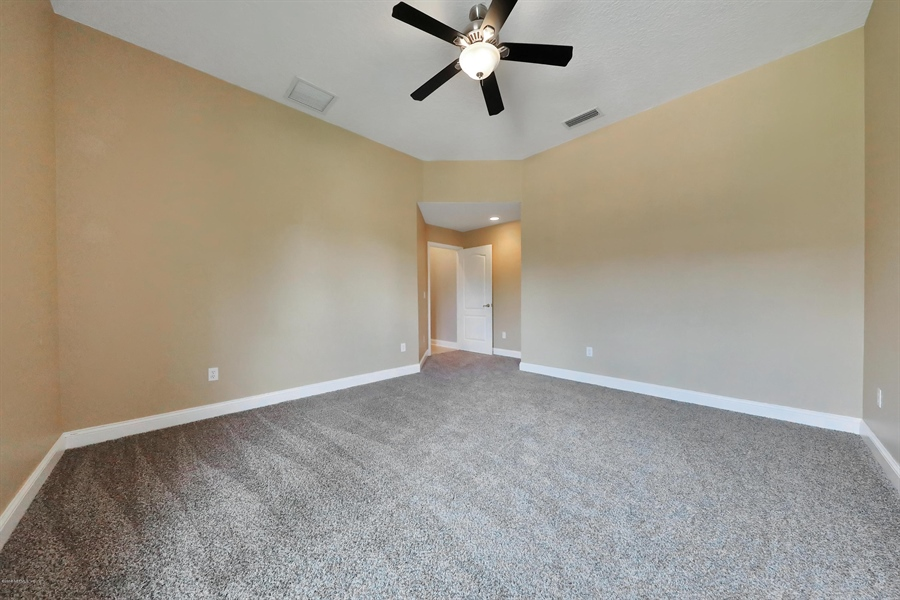 Real Estate Photography - 140 Saint Johns Forest Blvd, Saint Johns, FL, 32259 - SPACIOUS BEDROOM