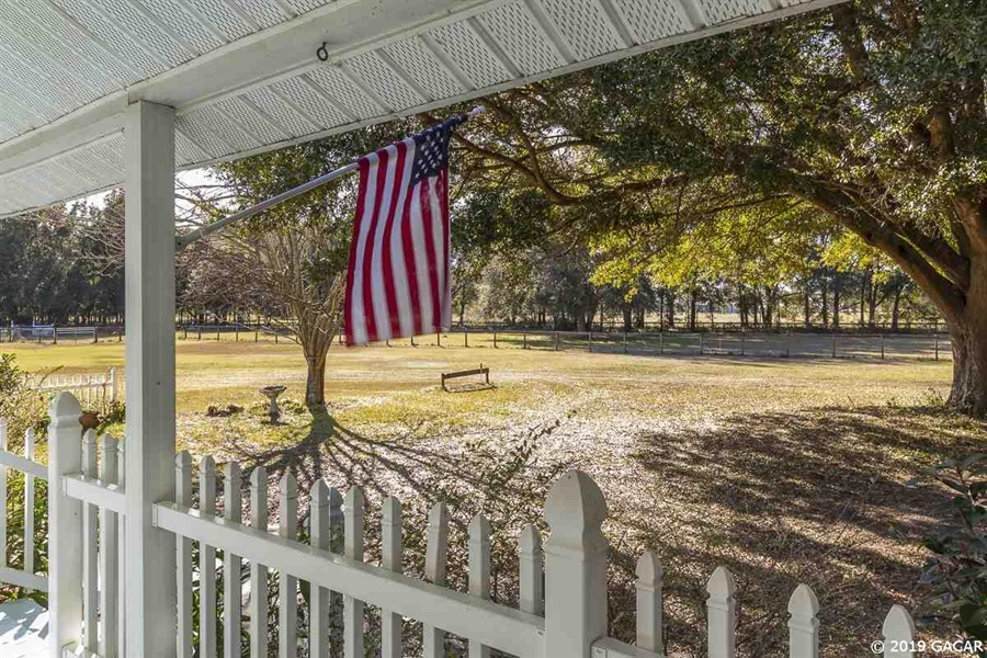 Real Estate Photography - 6530 NE 57th Ct, High Springs, FL, 32643 - View from front porch - Main House