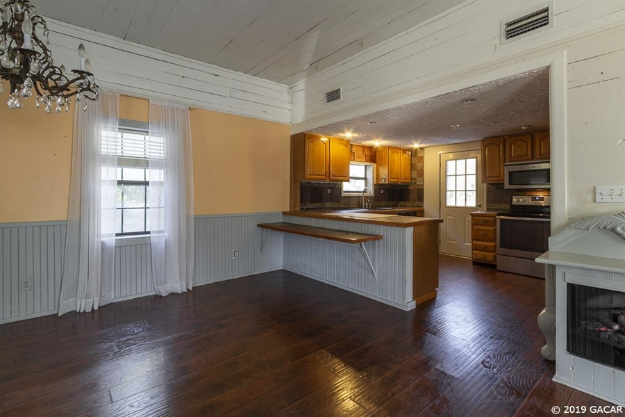 Real Estate Photography - 6530 NE 57th Ct, High Springs, FL, 32643 - Kitchen/Dining Room - Main House