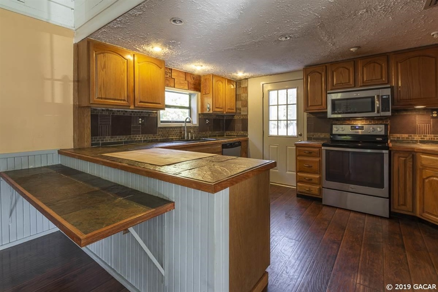 Real Estate Photography - 6530 NE 57th Ct, High Springs, FL, 32643 - Kitchen - Main House