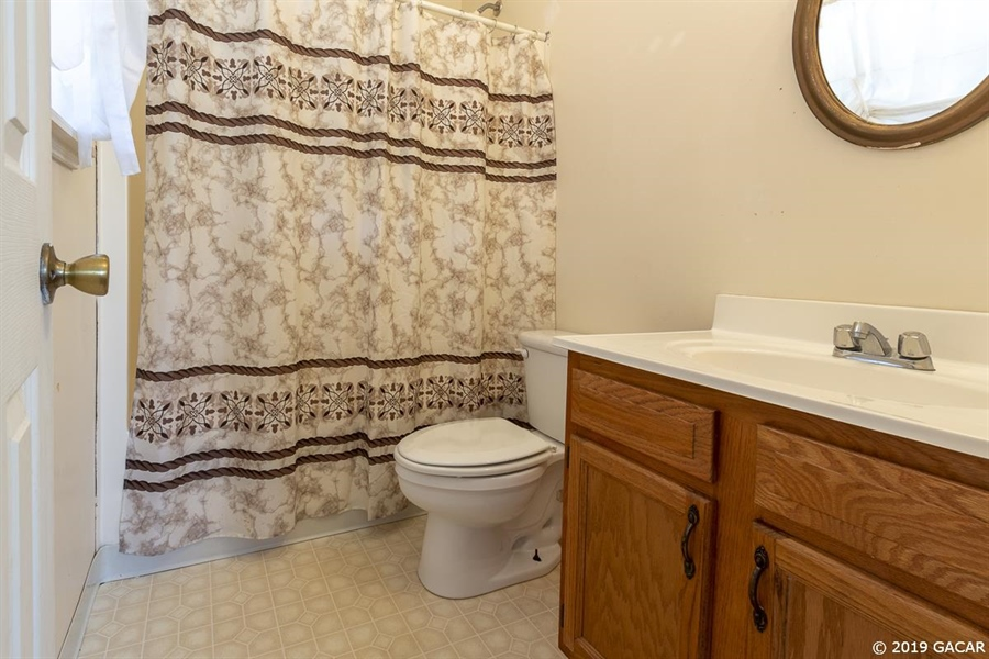 Real Estate Photography - 6530 NE 57th Ct, High Springs, FL, 32643 - Cottage Full Bath