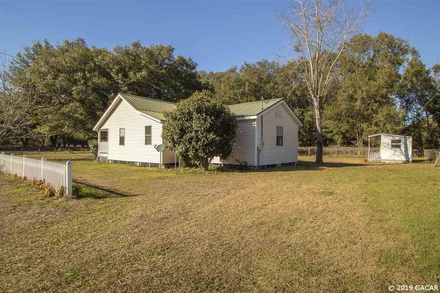 Real Estate Photography - 6530 NE 57th Ct, High Springs, FL, 32643 - Rear of Main House and Laundry Cottage