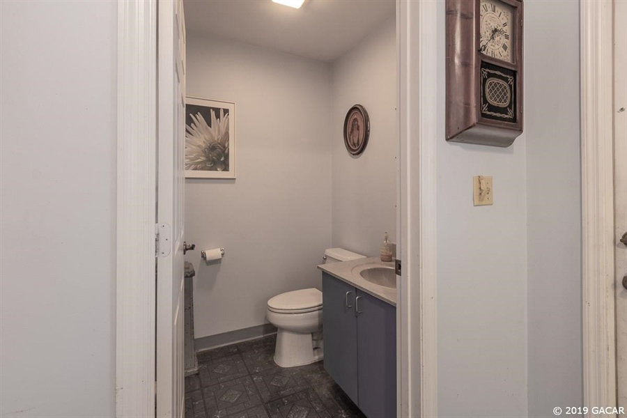 Real Estate Photography - 6530 NE 57th Ct, High Springs, FL, 32643 - Office Rest Room