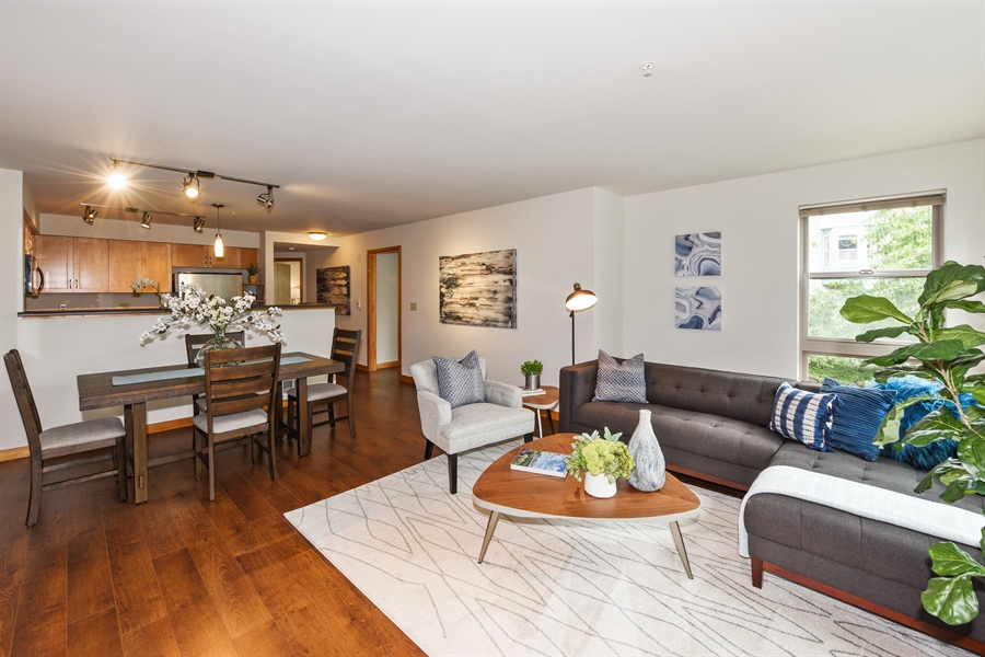 Real Estate Photography - 827 Hiawatha Pl S, 214, Seattle, WA, 98144 - Living Room / Dining Room