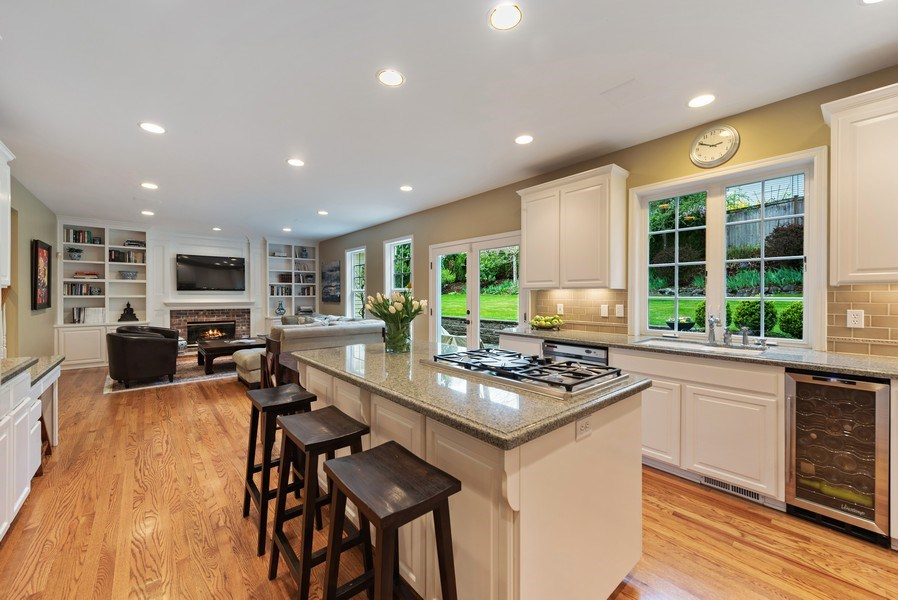 Real Estate Photography - 2401 100th Ave NE, Bellevue, WA, 98004 - Family Room / Kitchen