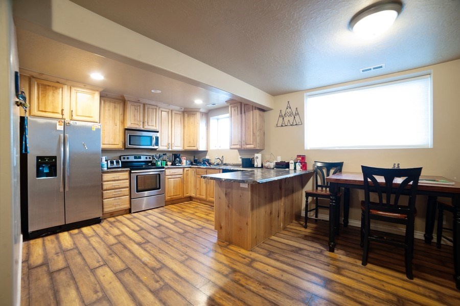 Real Estate Photography - 470 E South Poco Dr, Roosevelt, UT, 84066 - Kitchen/Dining