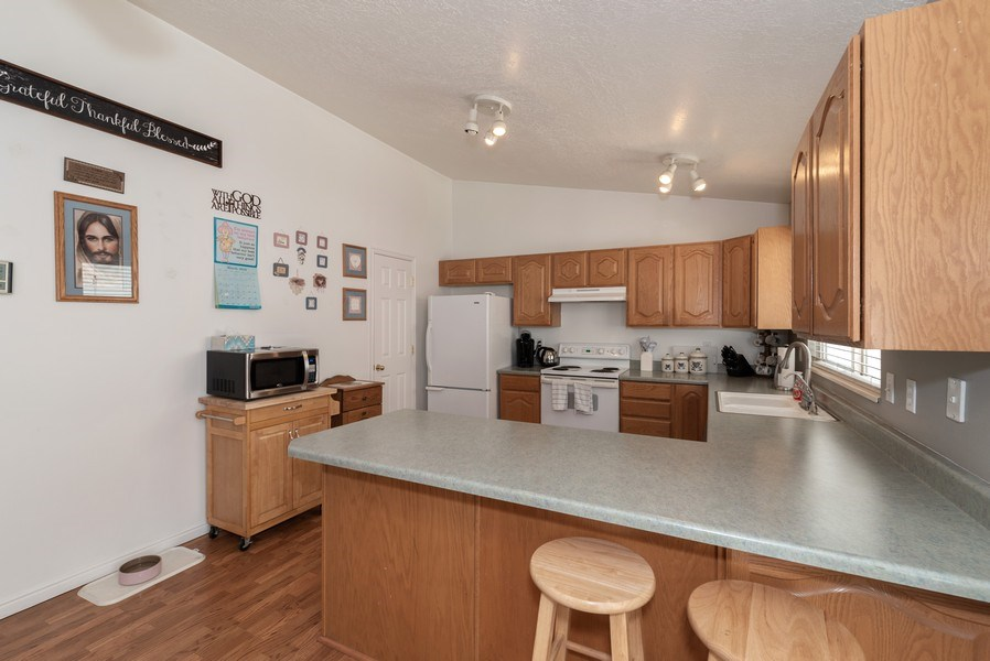 Real Estate Photography - 2894 Woodbrook Lane, Magna, UT, 84044 - Kitchen
