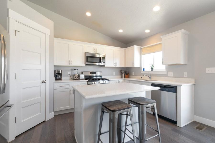 Real Estate Photography - 2358 E Jim Bridger Dr, Eagle Mountain, UT, 84005 - Kitchen